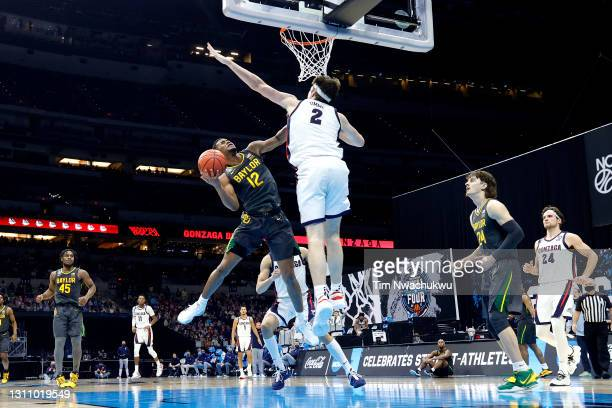Jared Butler of the Baylor Bears goes up to the basket against Drew Timme of the Gonzaga Bulldogs in the National Championship game of the 2021 NCAA...