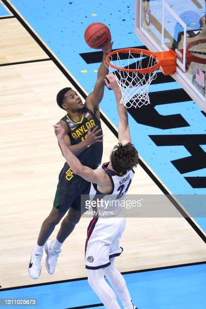 Jared Butler of the Baylor Bears goes up to the basket over Corey Kispert of the Gonzaga Bulldogs in the National Championship game of the 2021 NCAA...