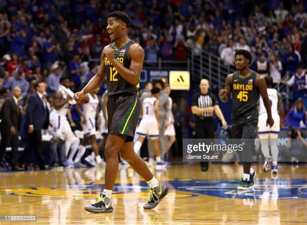 Jared Butler of the Baylor Bears reacts after scoring during the game against the Kansas Jayhawks at Allen Fieldhouse on January 11, 2020 in...