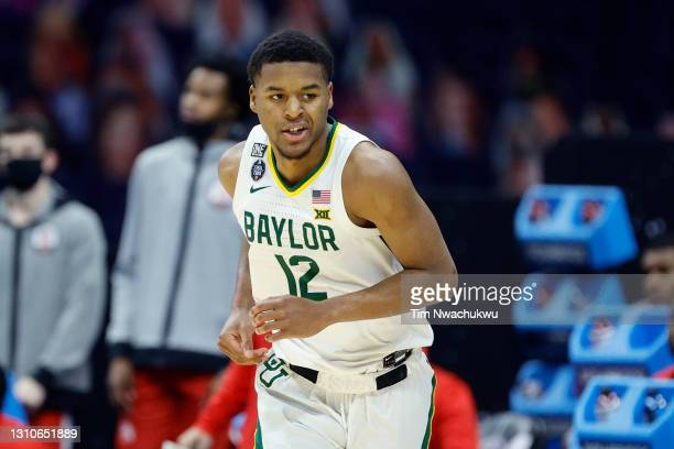 Jared Butler of the Baylor Bears reacts in the first half against the Houston Cougars during the 2021 NCAA Final Four semifinal at Lucas Oil Stadium...