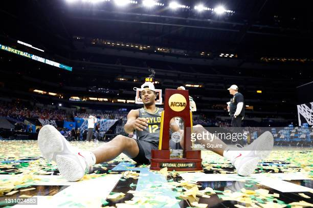Jared Butler of the Baylor Bears sits on the court with the trophy after defeating the Gonzaga Bulldogs 86-70 in the National Championship game of...