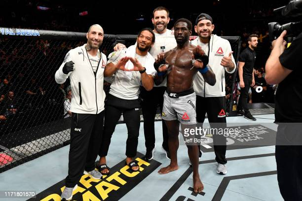 Jared Cannonier and his team pose for a photo after his TKO victory over Jack Hermansson of Sweden in their middleweight bout during the UFC Fight...