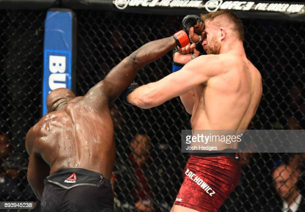 Jared Cannonier punches Jan Blachowicz of Poland in their light heavyweight bout during the UFC Fight Night event at Bell MTS Place on December 16...