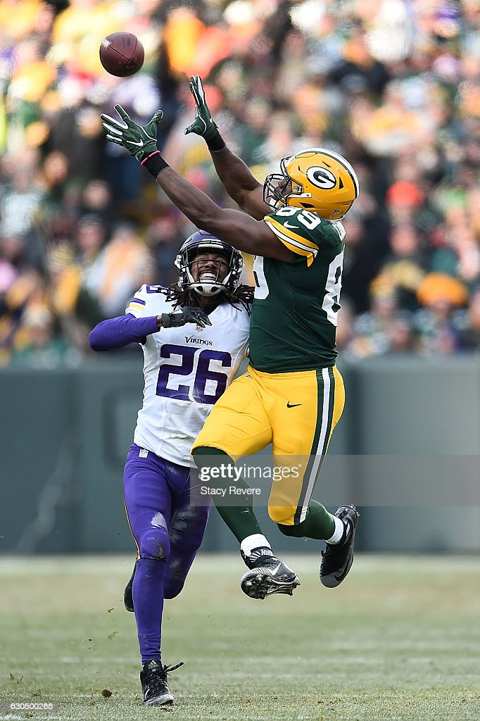 Jared Cook #89 of the Green Bay Packers catches a pass in front of Trae Waynes #26 of the Minnesota Vikings during the second half of a game at Lambeau Field on December 24, 2016 in Green Bay, Wisconsin.