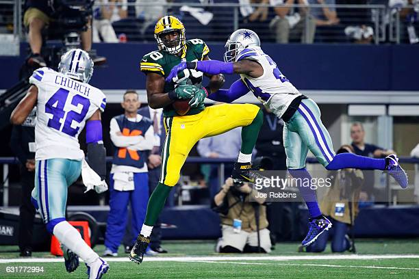 Jared Cook of the Green Bay Packers makes a catch while being defended by Morris Claiborne of the Dallas Cowboys in the second half during the NFC...