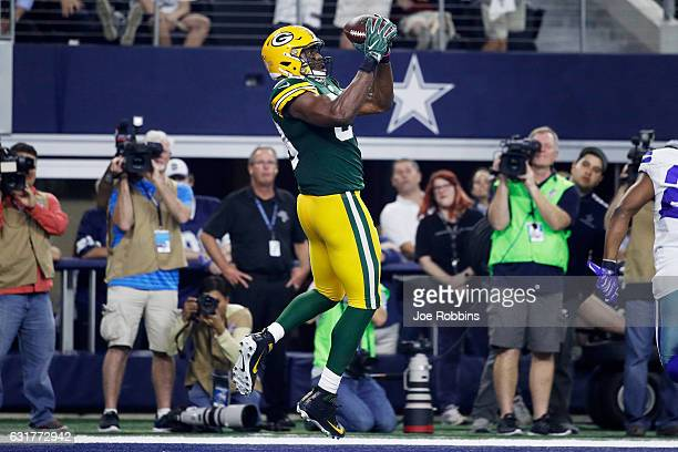 Jared Cook of the Green Bay Packers makes a touchdown catch in the second half during the NFC Divisional Playoff Game against the Dallas Cowboys at...