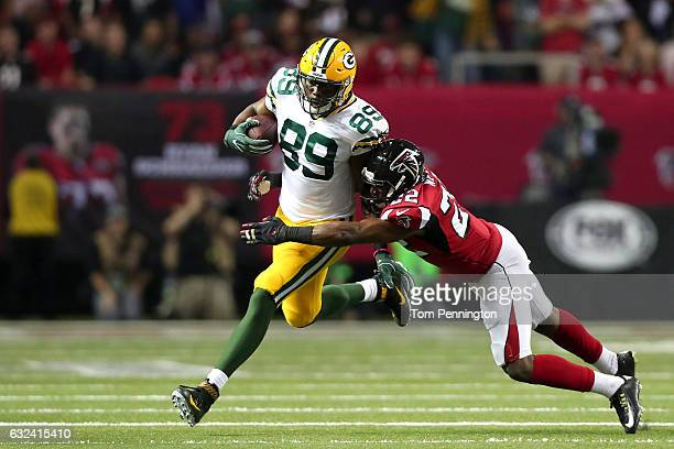 Jared Cook of the Green Bay Packers runs after a catch in the second half against Keanu Neal of the Atlanta Falcons in the NFC Championship Game at...