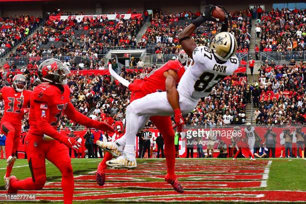 Jared Cook of the New Orleans Saints catches a 3yard touchdown pass thrown by Drew Brees during the second quarter of a football game against the...