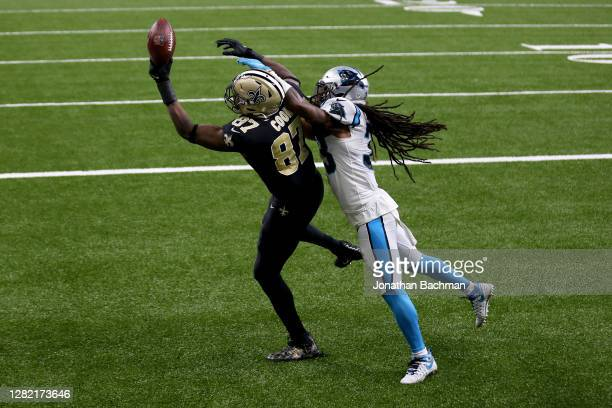 Jared Cook of the New Orleans Saints catches a touchdown pass while being guarded by Tre Boston of the Carolina Panthers in the first quarter at the...