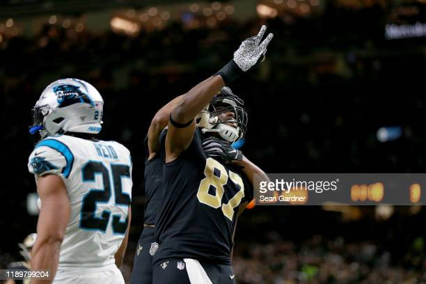 Jared Cook of the New Orleans Saints celebrates after scoring a 20 yard touchdown against the Carolina Panthers during the third quarter in the game...