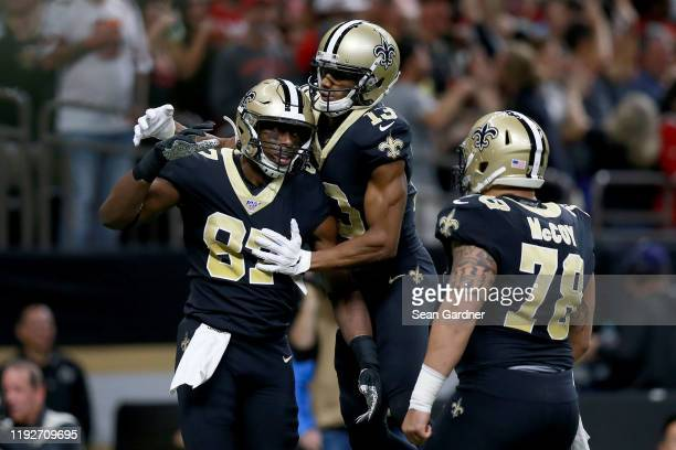Jared Cook of the New Orleans Saints celebrates with his teammates Michael Thomas and Erik McCoy as he scores a 38 yard touchdown against the San...