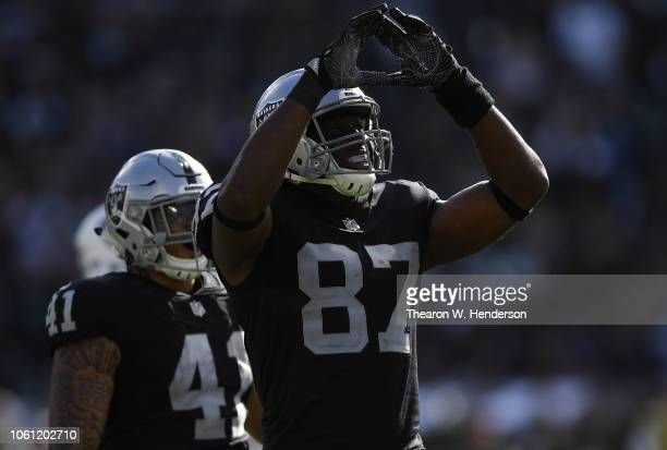 Jared Cook of the Oakland Raiders celebrates after catching a long pass for a firs down against the Indianapolis Colts during the second half of...