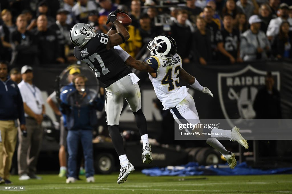 Jared Cook #87 of the Oakland Raiders makes a catch against John Johnson #43 of the Los Angeles Rams during their NFL game at Oakland-Alameda County Coliseum on September 10, 2018 in Oakland, California.