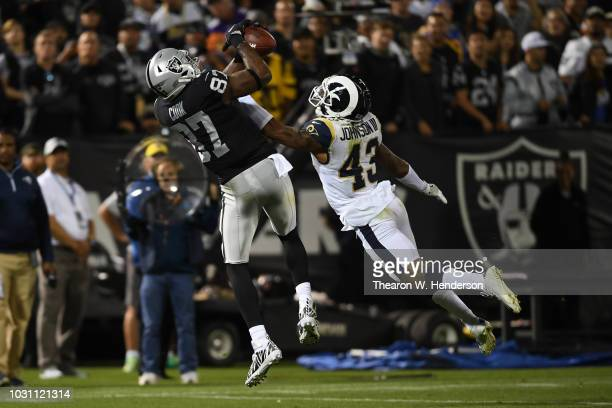 Jared Cook of the Oakland Raiders makes a catch against John Johnson of the Los Angeles Rams during their NFL game at OaklandAlameda County Coliseum...