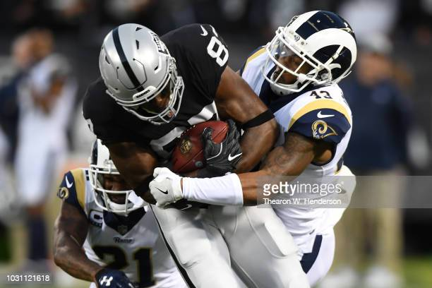 Jared Cook of the Oakland Raiders runs after a catch against the Los Angeles Rams during their NFL game at OaklandAlameda County Coliseum on...