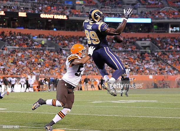 Jared Cook of the St Louis Rams can't make a catch in front of Craig Robertson of the Cleveland Browns at FirstEnergy Stadium on August 23 2014 in...