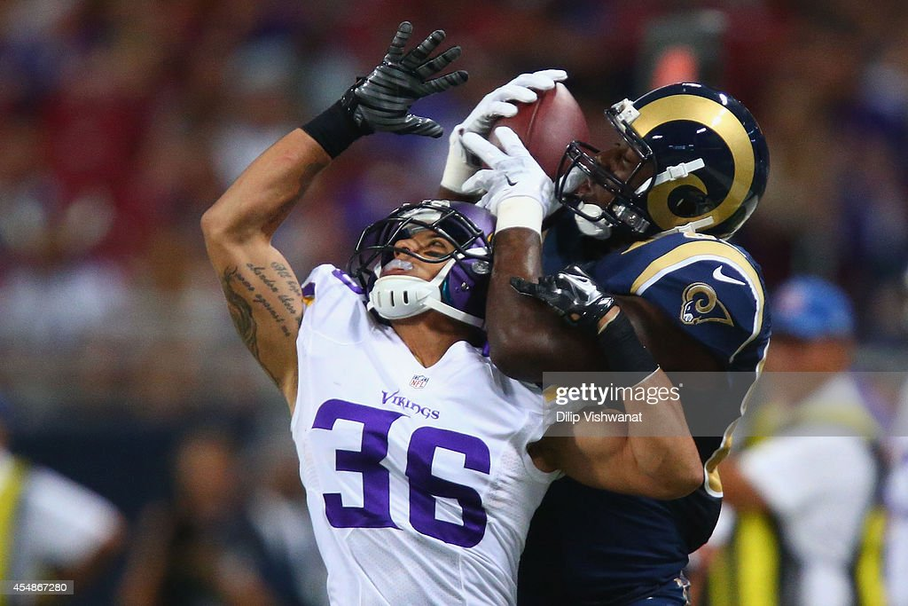 Jared Cook #89 of the St. Louis Rams makes a catch against Robert Blanton #36 of the Minnesota Vikings at the Edward Jones Dome on September 7, 2014 in St. Louis, Missouri. The Vikings beat the Rams 34-6.