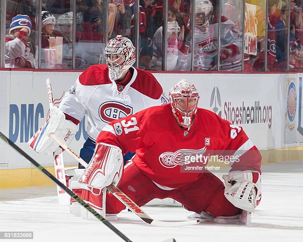 Jared Coreau of the Detroit Red Wings and Carey Price of the Montreal Canadiens warmup prior to an NHL game at Joe Louis Arena on January 16 2017 in...