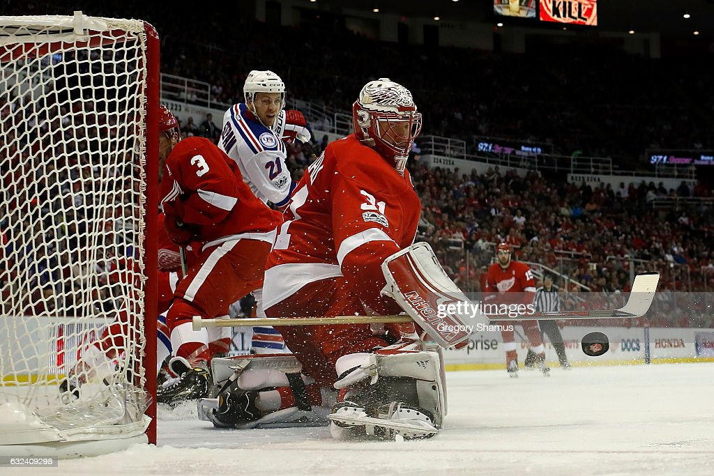 Jared Coreau #31 of the Detroit Red Wings makes a save while playing the New York Rangers at Joe Louis Arena on January 22, 2017 in Detroit, Michigan. New York won the game 1-0 in overtime.