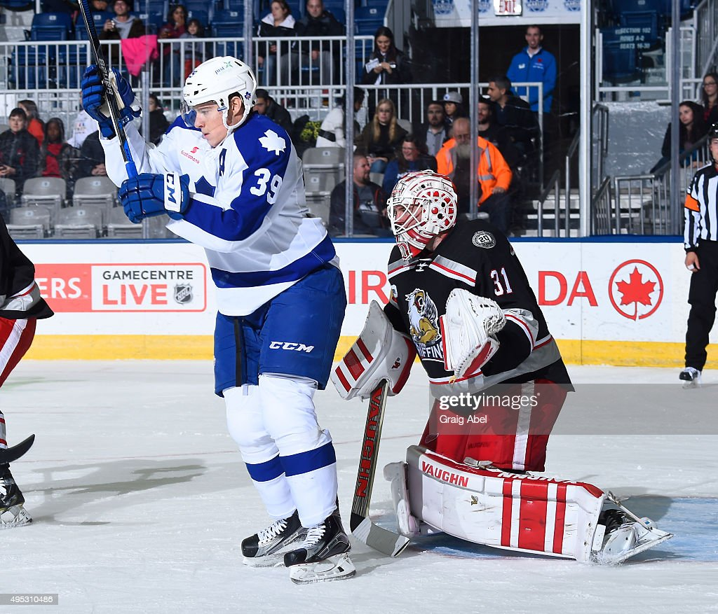 Jared Coreau #31 of the Grand Rapids Griffins is screened by Matt Frattin #39 of the Toronto Marlies during AHL game action on October 30, 2015 at Ricoh Coliseum in Toronto, Ontario, Canada.