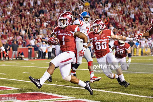 Jared Cornelius of the Arkansas Razorbacks rushes for the winning touchdown in the second half of a game against the Mississippi Rebels at Razorback...
