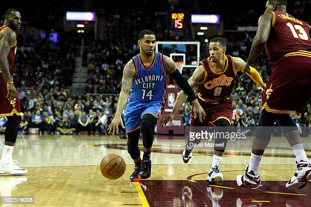 Jared Cunningham of the Cleveland Cavaliers defends against DJ Augustin of the Oklahoma City Thunder during the first half of their game on December...
