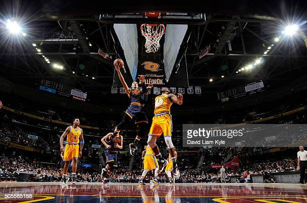 Jared Cunningham of the Cleveland Cavaliers goes for the layup against Jason Thompson of the Golden State Warriors during the game on January 18 2016...