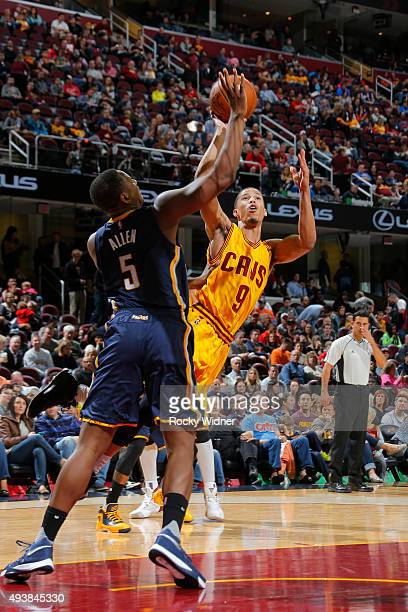 Jared Cunningham of the Cleveland Cavaliers shoots against Lavoy Allen of the Indiana Pacers on October 15 2015 at Quicken Loans Arena in Cleveland...