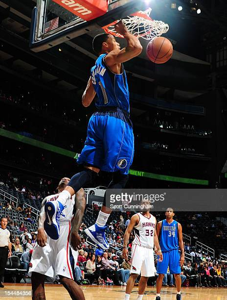 Jared Cunningham of the Dallas Mavericks dunks the ball against the Atlanta Hawks at Philips Arena on October 20 2012 in Atlanta Georgia NOTE TO USER...