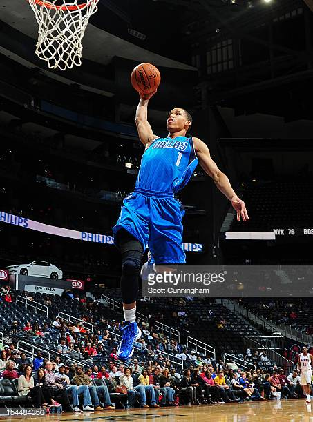 Jared Cunningham of the Dallas Mavericks goes in for the dunk against the Atlanta Hawks at Philips Arena on October 20 2012 in Atlanta Georgia NOTE...