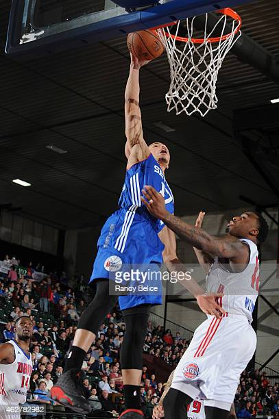 Jared Cunningham of the Delaware 87ers goes to the basket over LD Williams of the Grand Rapids Drive during the NBA DLeague game on January 31 2015...