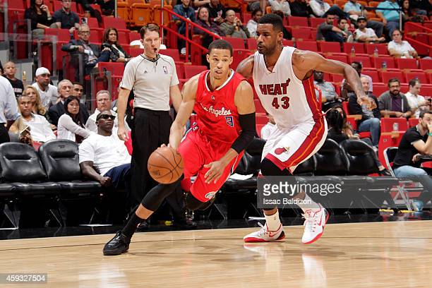 Jared Cunningham of the Los Angeles Clippers drives to the basket as Shawne Williams of the Miami Heat follows behind during the game at the American...