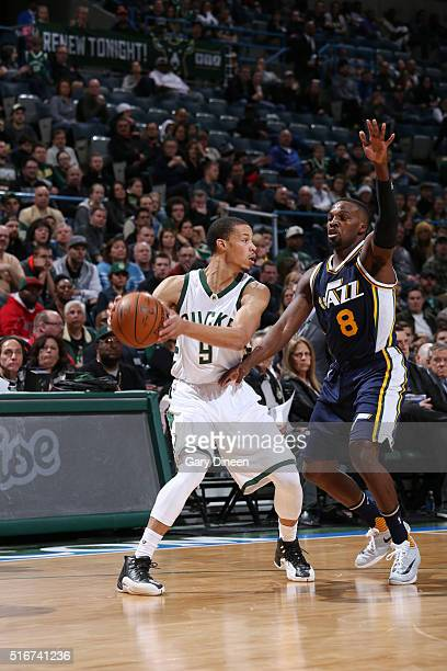 Jared Cunningham of the Milwaukee Bucks handles the ball against Shelvin Mack of the Utah Jazz on March 20 2016 at the BMO Harris Bradley Center in...