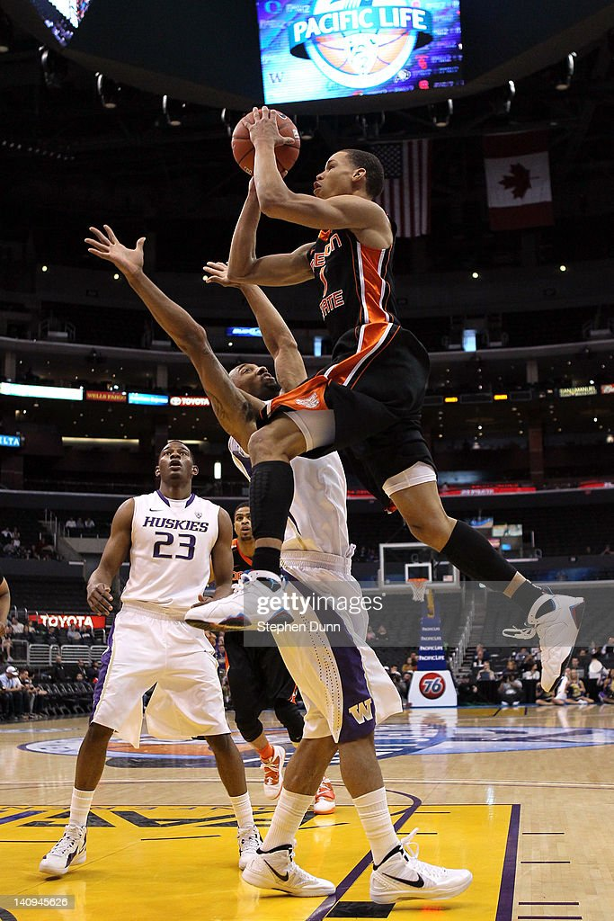 Jared Cunningham #1 of the Oregon State Beavers goes up for a shot over Desmond Simmons #30 of the Washington Huskies in the first half during the quarterfinals of the 2012 Pacific Life Pac-12 basketball tournament at Staples Center on March 8, 2012 in Los Angeles, California.
