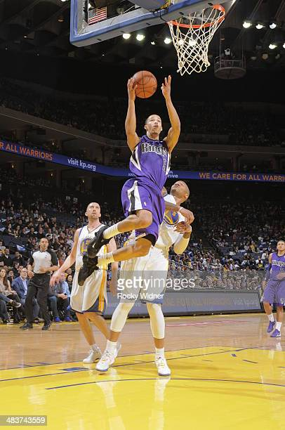 Jared Cunningham of the Sacramento Kings shoots a layup against Marreese Speights of the Golden State Warriors on April 4 2014 at Oracle Arena in...