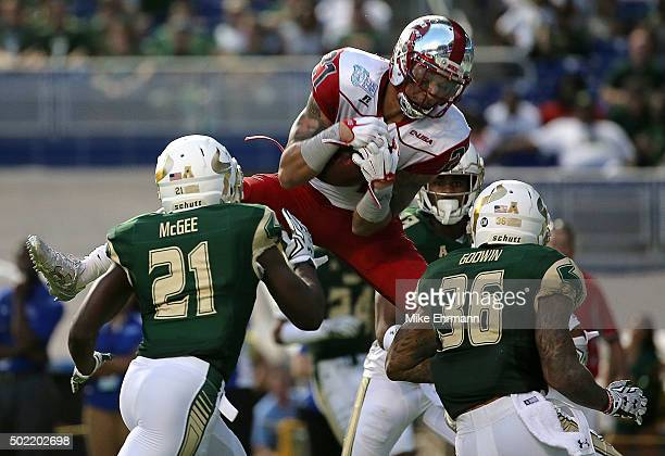 Jared Dangerfield of the Western Kentucky Hilltoppers scores a touchdown during the 2015 Miami Beach Bowl against the South Florida Bulls at Marlins...