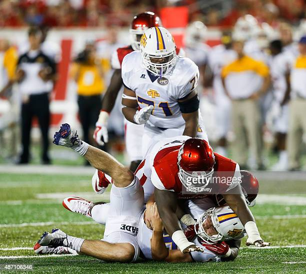 Jared Davis of the Tennessee Tech Golden Eagles is sacked by Tyus Bowser of the Houston Cougars and Tomme Mark of the Houston Cougars on September 5...