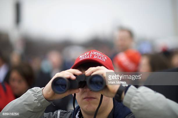 Jared Dickerson looks towards the U.S. Capitol Building with binoculars during the inauguration of Donald Trump being sworn in as the 45th President...