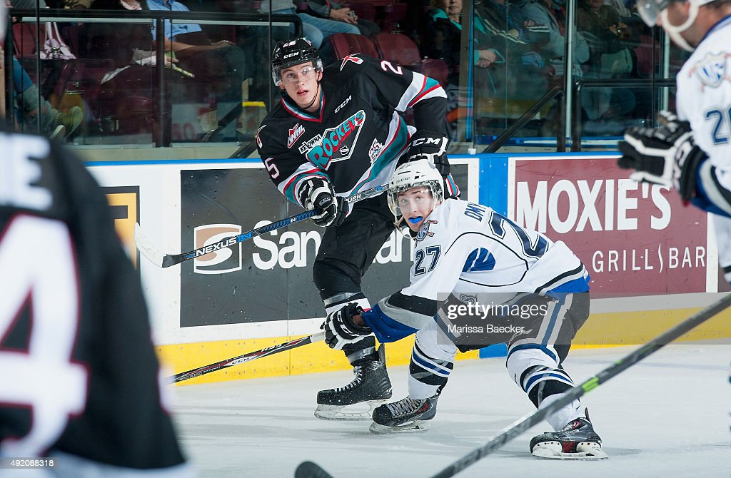 Jared Dmytriw #27 of Victoria Royals checks Cal Foote #25 of Kelowna Rockets on OCTOBER 9, 2015 at Prospera Place in Kelowna, British Columbia, Canada.