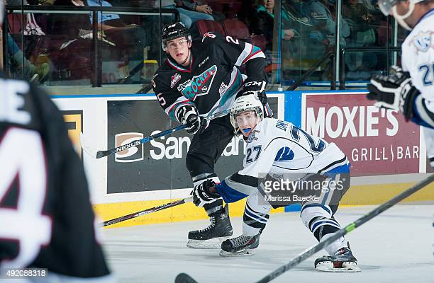 Jared Dmytriw of Victoria Royals checks Cal Foote of Kelowna Rockets on OCTOBER 9 2015 at Prospera Place in Kelowna British Columbia Canada