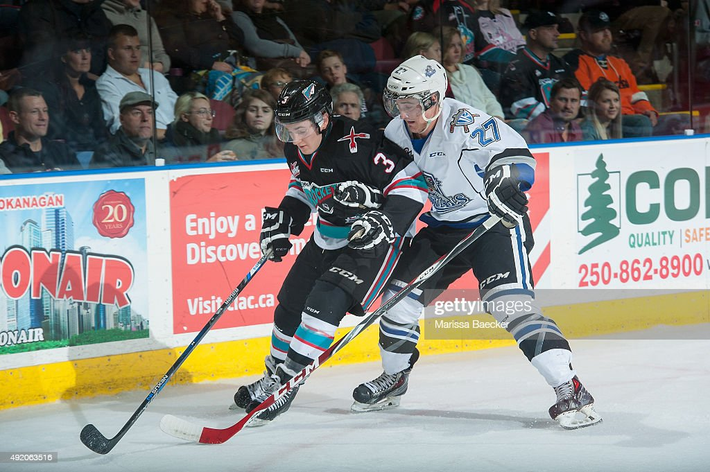 Jared Dmytriw #27 of Victoria Royals checks Riley Stadel #3 of Kelowna Rockets during the first period on OCTOBER 9, 2015 at Prospera Place in Kelowna, British Columbia, Canada.