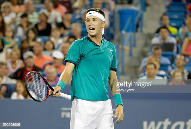 Jared Donaldson celebrates after winning the first set in his second round match against Stan Wawrinka of Switzerland on day 4 of the Western...