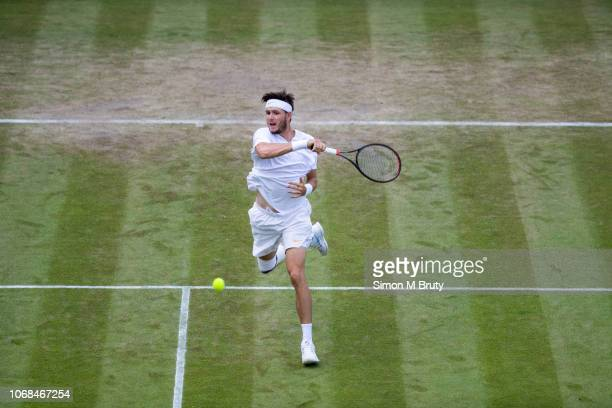 Jared Donaldson from USA in action against Stefanos Tsitsipas from Greece during the Wimbledon Lawn Tennis Championship at the All England Lawn...