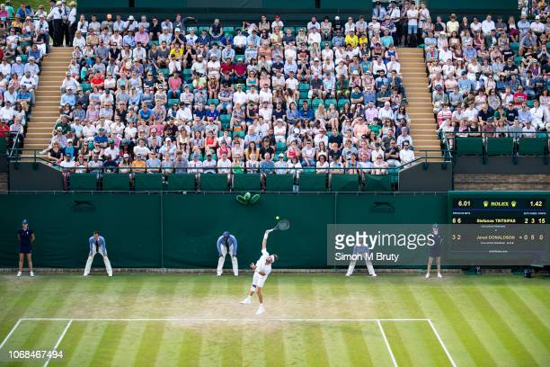 Jared Donaldson from USA in action on court 18 during the Wimbledon Lawn Tennis Championship at the All England Lawn Tennis and Croquet Club at...
