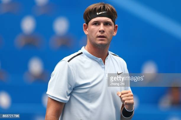 Jared Donaldson of the United States celebrates a point during the match against Stefanos Tsitsipas of Greece during Day 1 of 2017 ATP Chengdu Open...