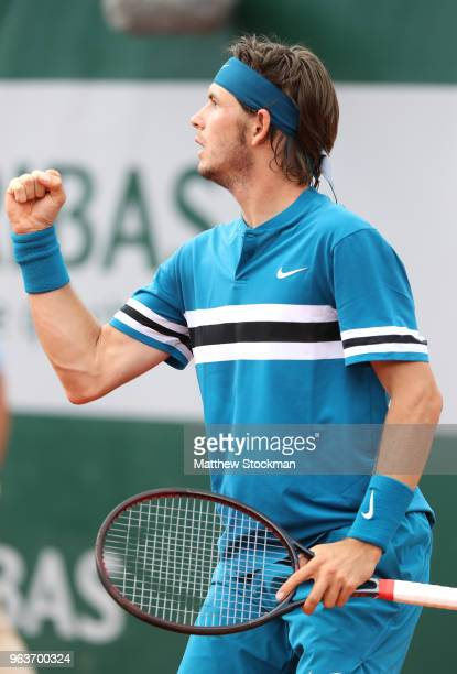 Jared Donaldson of The United States celebrates winning the third set during the mens singles second round match against Grigor Dimitrov of Bulgaria...