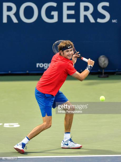 Jared Donaldson of the United States hits a return shot against Benoit Paire of France during day five of the Rogers Cup presented by National Bank...