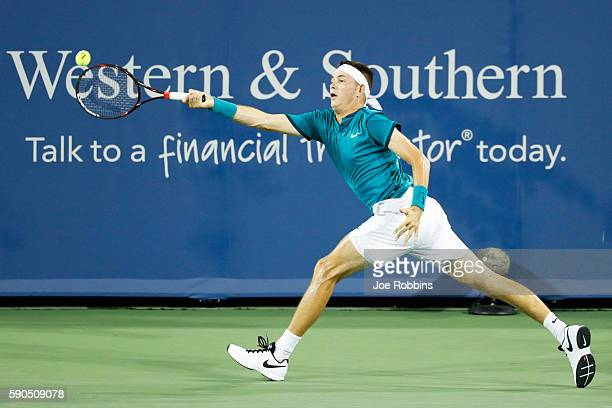 Jared Donaldson of the United States hits a return to Stan Wawrinka of Switzerland on Day 4 of the Western Southern Open at the Lindner Family Tennis...