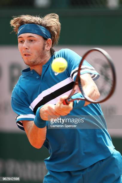 Jared Donaldson of the United States plays a backhand during his first round men's singles match against Nicolas Jarry of Chile on day one of the...