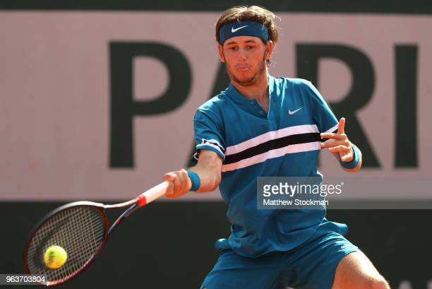 Jared Donaldson of The United States plays a forehand during the mens singles second round match against Grigor Dimitrov of Bulgaria during day four...